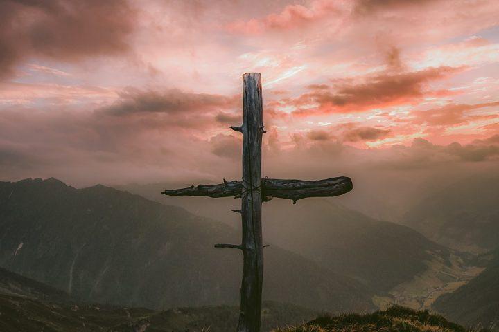 grey wooden cross on mountain